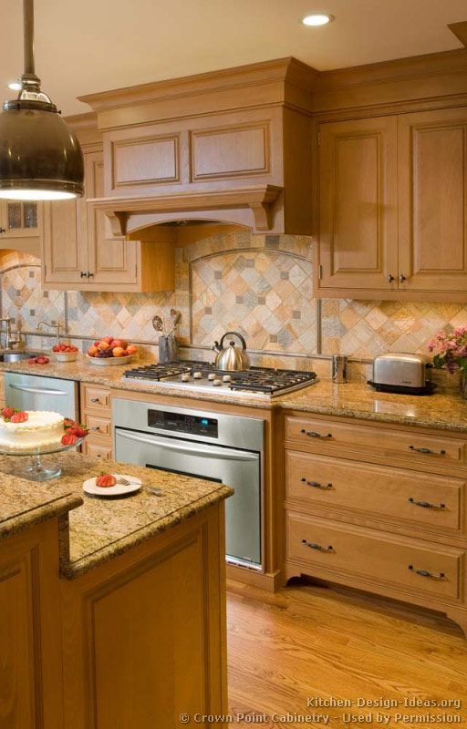 Idea of the Day: Natural & light wood kitchen (by Crown Point Cabinetry)  with a lovely multicolor stone tile backsplash!