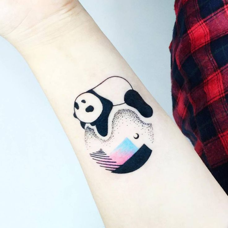 Panda Bear tattoo on the inner forearm.
