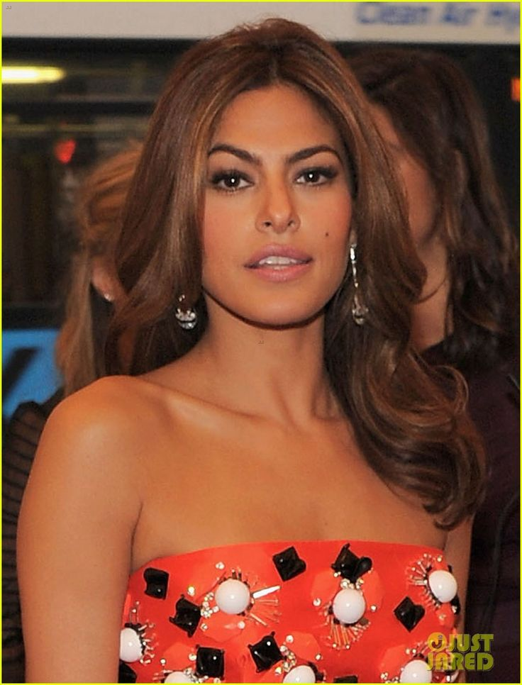 Eva Mendes in Prada and Fred Leighton - a pair of Art Deco coral, diamond and onyx ear pendants at the Met Gala 2012.