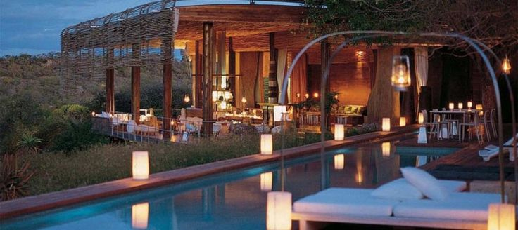 """Singita Lebombo Lodge This luxury lodge, which is certified """"green"""", consists of 15 suites, each positioned in niches on a ridge, with views over the river valley below. The lodge offers full spa and gym facilities and the reserve is home to the Big 5."""