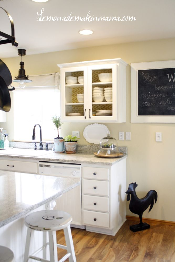 My favorite things about my kitchen.  Glass fronted doors, and light, bright white paint.