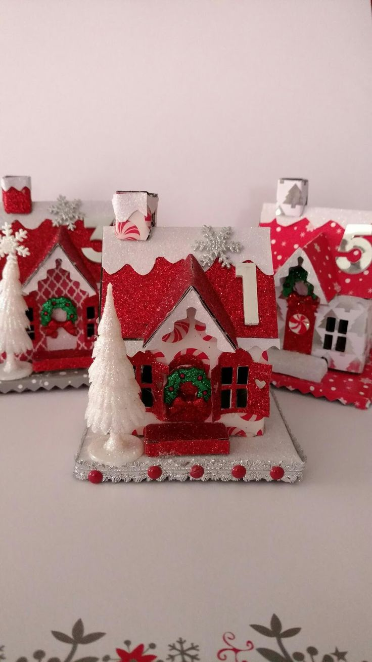 Been so busy not even time to breath. While the girls were at school I cut 25 houses only three are done. Love my Tim Holtz village die cuts...