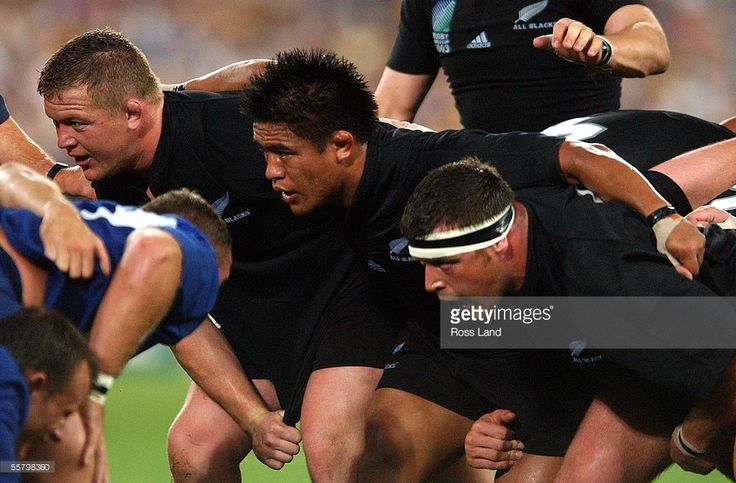 The All Black front row of (LR) Greg Somerville, Keven Mealamu and Dave Hewitt about to pack down in the scrum against France in their Rugby World Cup 2003 third and fourth playoff match at the Sydney Olympic Stadium, Thursday.