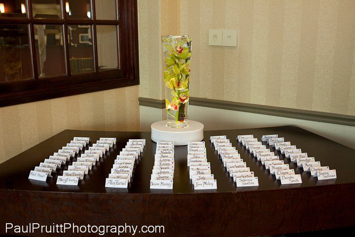 Illuminated submerged orchid to add color to the escort card table.