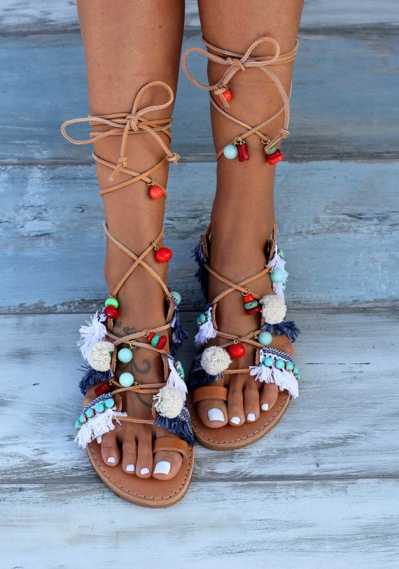 Handmade and handsewn greek leather sandals made to order. Blue and white fabric trims and fringes, white pom poms and turquoise metallic trims, all these are sewn by hand on the leather straps. Dazzling, colorful semi precious stones and corals embellish the sandals. Danae sandals are created in the name of the greek islands and summer vacation! They are the result of lots of summer memories. Warm, sunny days well spent by the aegean sea and Cyclades islands with their blue and white cha...