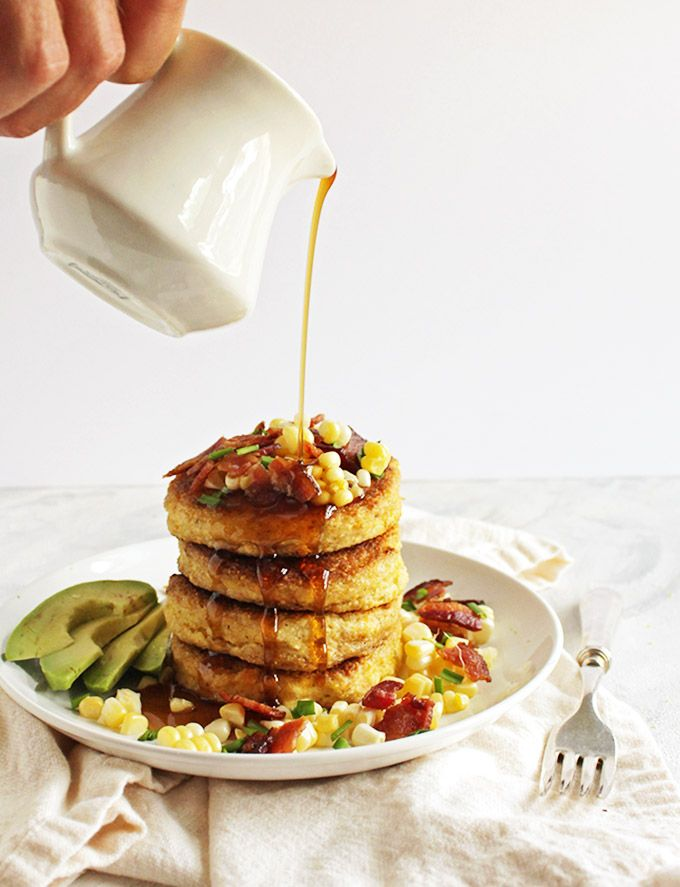 Savory cornmeal pancakes are topped with crispy bacon, fresh corn kernels, avocado slices. & maple syrup. Perfect weekend breakfast recipe. (gluten free)