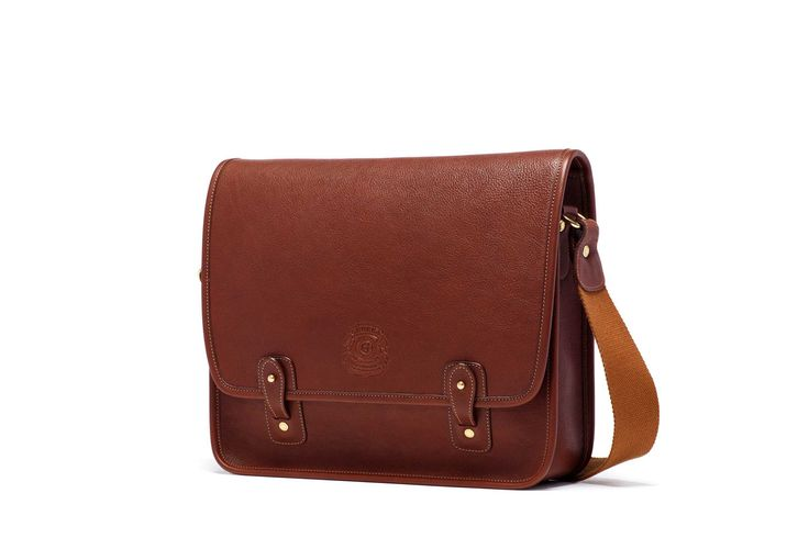 A multipurpose, roomy messenger style that can accommodate books, documents, most magazines and up to a 15-inch laptop. Ghurka signature post and tab closure provides security and classic styling. http://www.zocko.com/z/JJ6SG