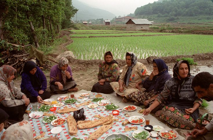 "hopeful-melancholy: ""  Iranian women share lunch after planting rice. Mazandaran Province. Near the village of Zirab. Iran, 2001. A.Abbas """
