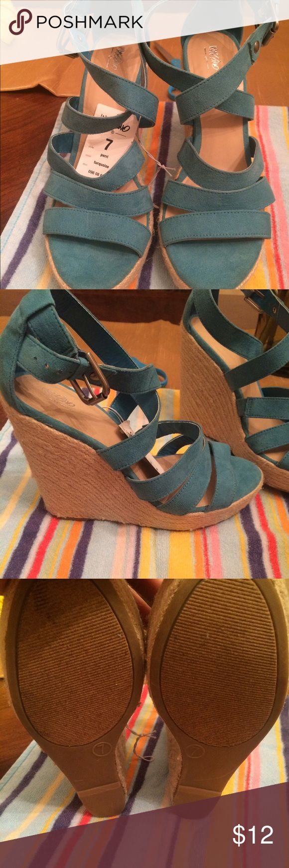Mossimo teal wedge perfect for summer NWT Bought these at target have never worn them only tried them on but they are too tall for me lol.  They are a SIZE 7 and NWT and teal/turquoise-ish in color Mossimo Supply Co Shoes Wedges
