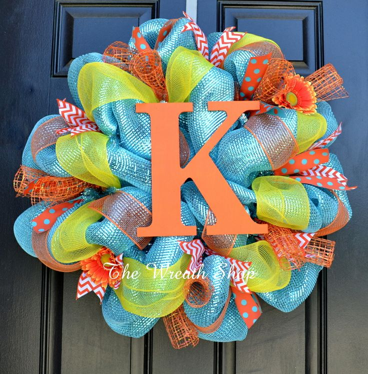bright summer mesh wreath with monogram on sparkly turquoise deco mesh with orange and yellow