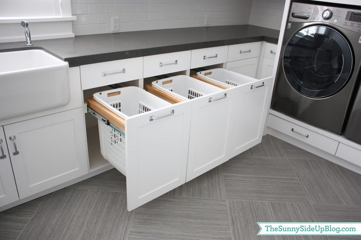 Pull-out laundry baskets in the laundry room. Dreamy laundry room...