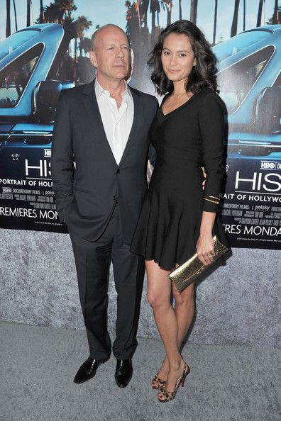 """Actor Bruce Willis and wife Emma Heming arrive to the premiere of the HBO documentary """"His Way"""" on March 22, 2011 in Hollywood, California."""