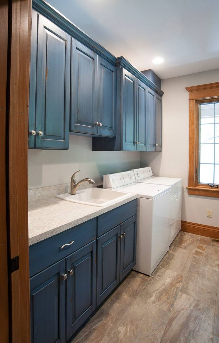 Laundry room with blue cabinets!!