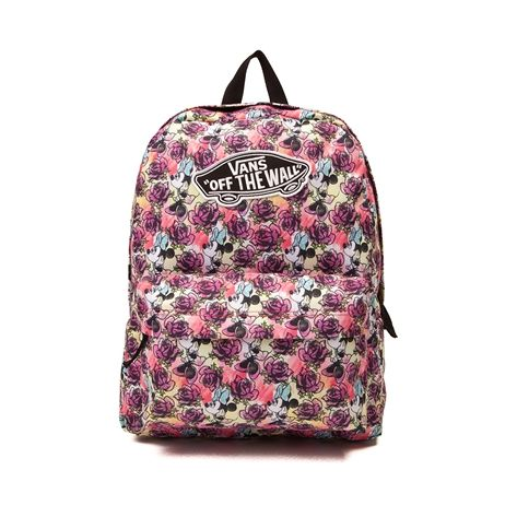"""Add some floral flair to your look with the new Minnie Mouse Backpack from Vans! This season, Minnie Mouse has you covered, featuring a character printed exterior with logo patch, and plenty of compartment space for all of your essentials. Only available at Journeys and Underground by Journeys!    Features include   100% Polyester   Zipper closure   Front utility pocket with zipper closure   Vans """"Off the Wall"""" logo patch   Padded and adjustable shoulder straps"""