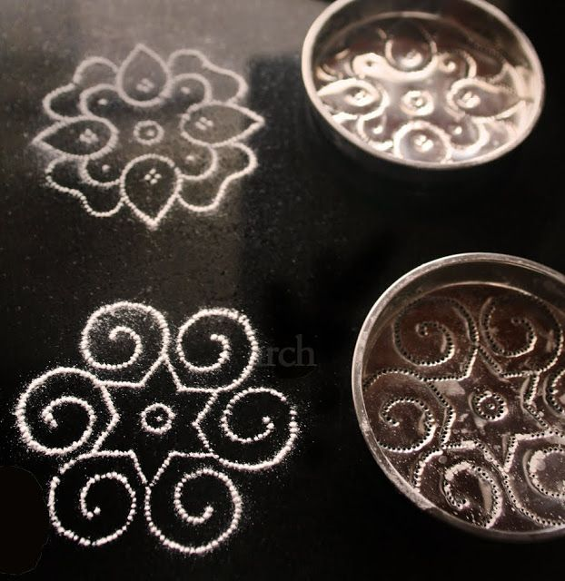 Delicate doily like patterns formed by Kolam stencils form the perfect background for placing tea-lights