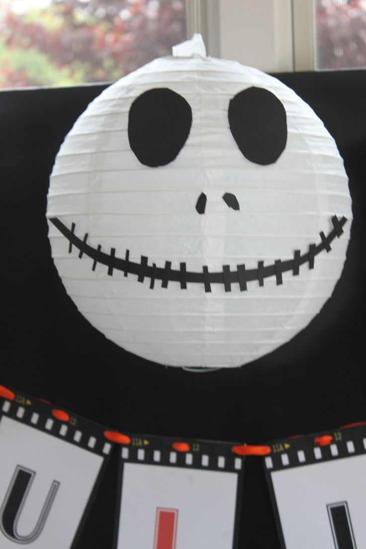 white paper lanterns made up to look like Jack Skellington's head