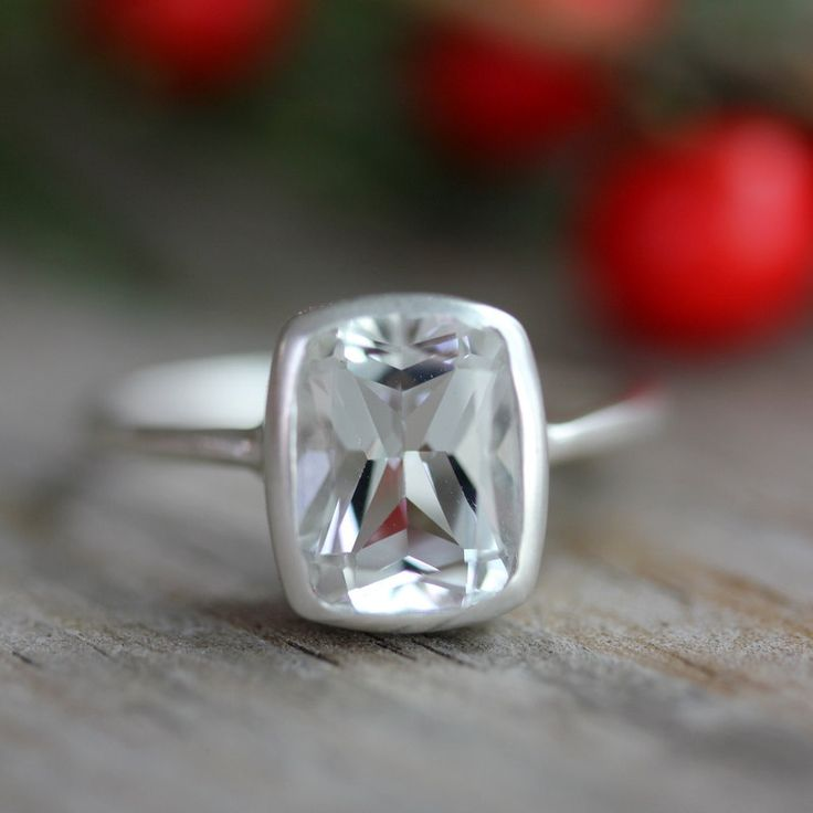 White Topaz and Matte Sterling Silver Cushion Solitaire Engagement Ring, Made To Order by Onegarnetgirl. $198.00, via Etsy.