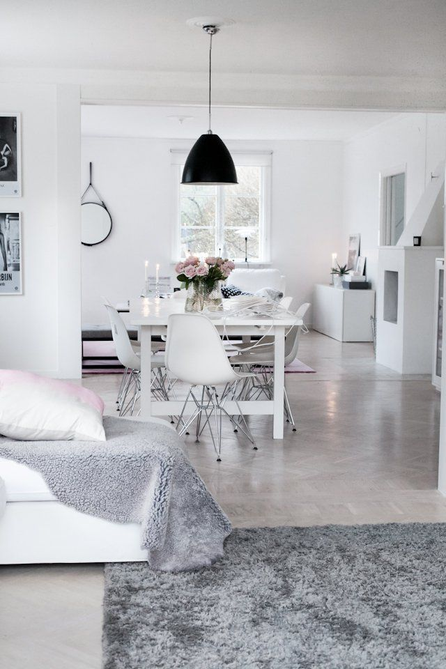 Modern whites, smooth concrete and cozy grays, pale pink and black hints