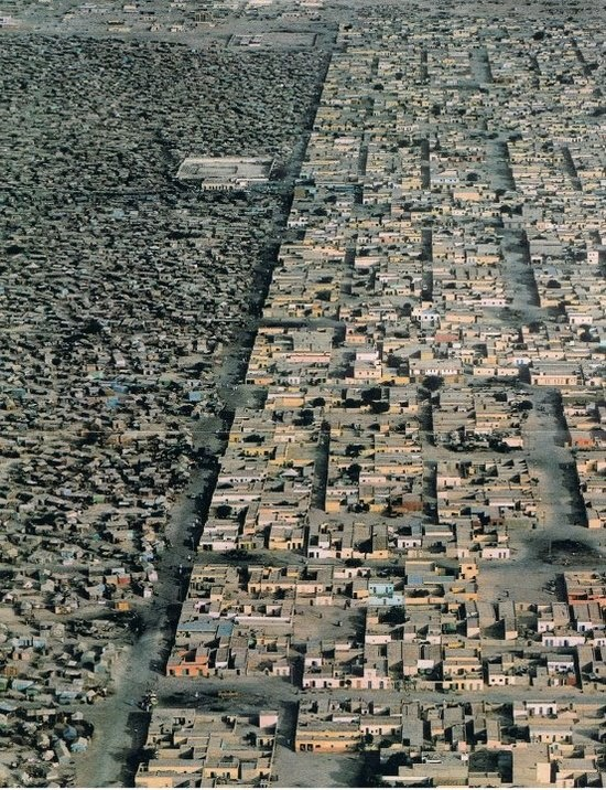 Mauritania. Slums in Nouakchott. You can see the clear line, slums on the left