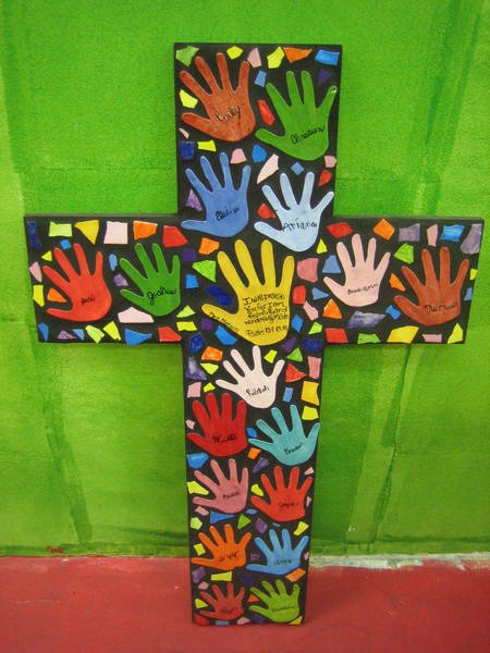 clay hand prints mounted in mosaic cross from ccsa studio share