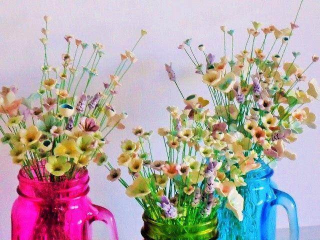 A gazillion teeny tiny ceramic flowers by Bron's Ceramcs