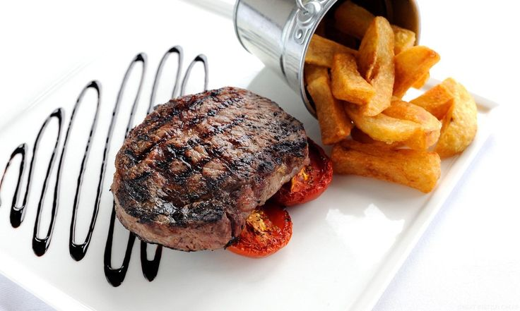 Josh Eggleton's steak recipe reads like a paean to the much vaunted rib-eye cut. The rib-eye is comfortingly paired with chunky chips, field mushrooms and vine tomatoes, while a balsamic glaze, which can be made well in advance, adds a restaurant quality touch to the dish