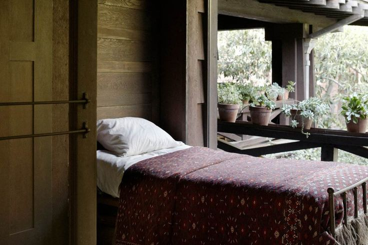A murphy bed folds out of the exterior wall on the sleeping porch. Photos: Artemesia, the biggest Craftsman ever built