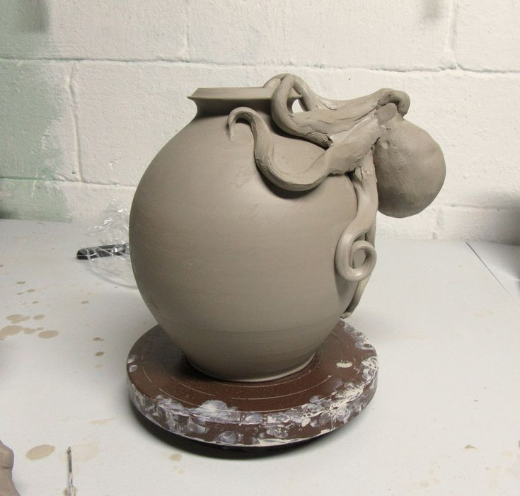 A work in progress octopus on a bottle - Ceramic bottle and octopus - Pottery and sculpture