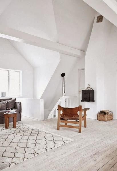 A white Copenhagen home with an industrial touch