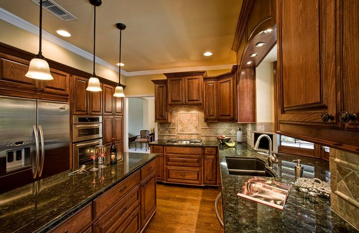 Traditional Kitchen with Bay window, Crown molding, Peacock Green Granite Countertop, Pendant Light, Inset cabinets, U-shaped