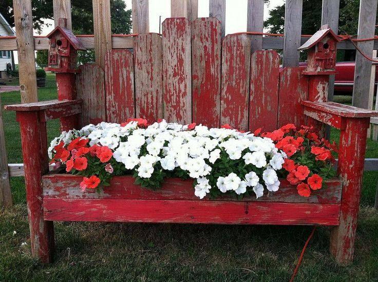garden bench planter box. this is a bench that used to sit in parents old yard. was looking pretty tired. had my husband turn it into flower bench. simply removed seat part and garden planter box