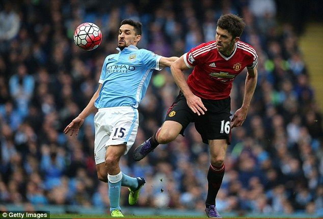 Michael Carrick (right) helped to marshall United's midfield seen here battling with Jesus Navas