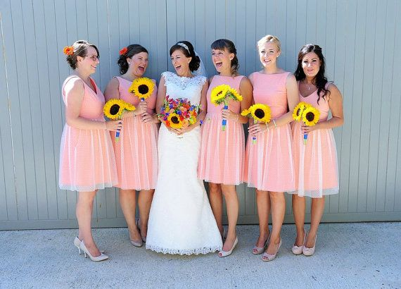 Love the Bridesmaid dresses. Very fun, comfy and could actually be worn again. Modern take on a vintage style dress!