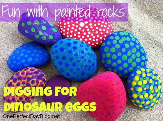 """Fun idea for a sensory tub / imaginative play scene. Bury painted rocks in the sensory tub and then dig for the dinosaur """"eggs"""". Love it!"""