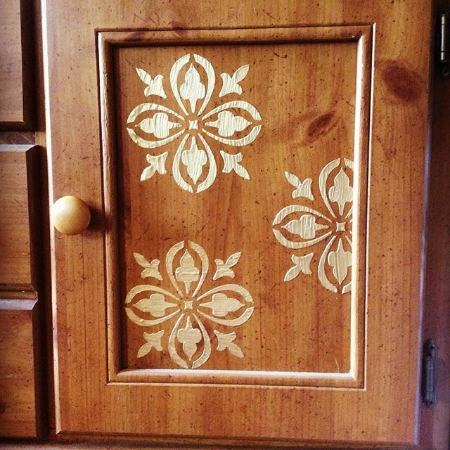 Raised Stenciling With Pale Gold On A Buffet Door By
