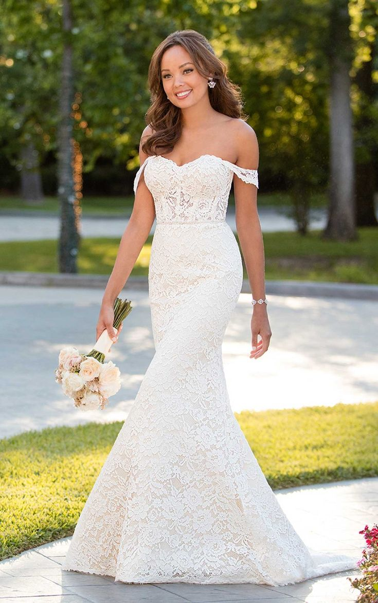 A chic style is what every romantic boho bride wants and designer Stella York delivers with this amazing off-the-shoulder wedding dress. Lace over Dolce satin creates a simple yet very elegant fit-and-flare silhouette with sweetheart neckline and natural waist. Cut-and-sew style lace pops with an all-over floral pattern that gives this dress a distinctive boho feeling.