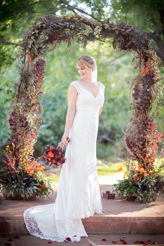 27 Fall Wedding Arches That Will Make You Say 'I Do!': #6. Moody dark fall wedding arch