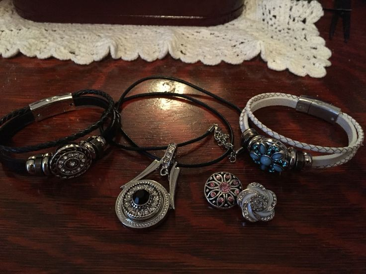 2 leather bracelets  1 pendant with 20 inch leather cord With 2 extra snap on charms