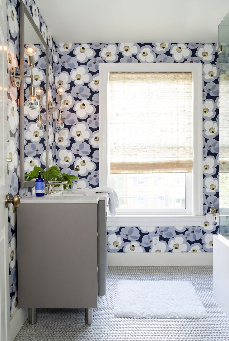 Bold grey and lavender modern wallpaper by Romo in a bathroom by Ella Scott Design. #bathroomdesign #wallpaper #modern #lavender #grey