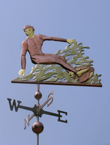 Surfing Weather Vane by West Coast Weather Vanes.  This Surfer weathervane was customized using optional gold and palladium leafing.