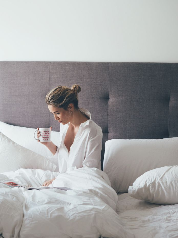 White bed linen and shirt