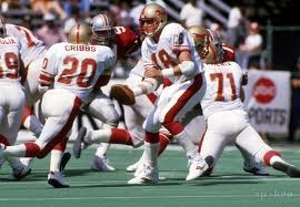 Birmingham Stallions quarterback Cliff Stoudt (18) hands off to Joe Cribbs (20)