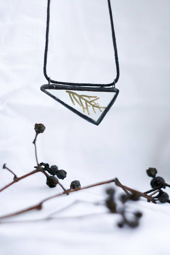 Triangle herbarium glass pendant with juniper inside. Stained