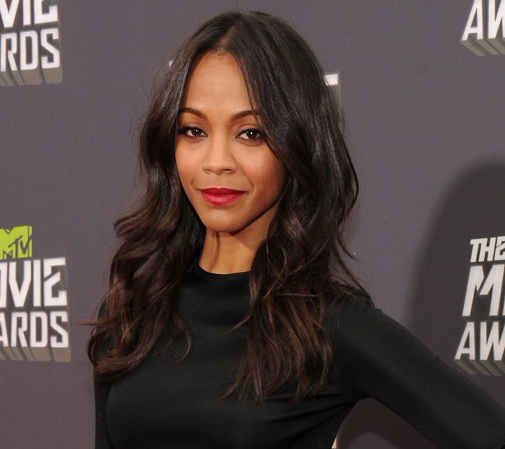 Zoe Saldana's beachy waves and red lips are perfection.