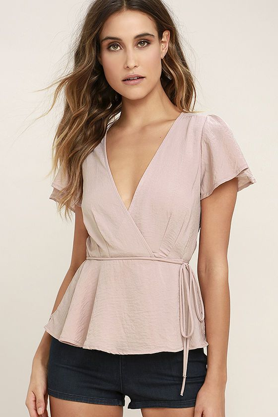 Even old-fashioned filles are falling for the chic, updated style of the Modern Gal Blush Wrap Top! This woven poly wrap top has a darted bodice, plunging neckline, and fluttering short sleeves. Waist tie allows a custom fit above a ruffled hem.