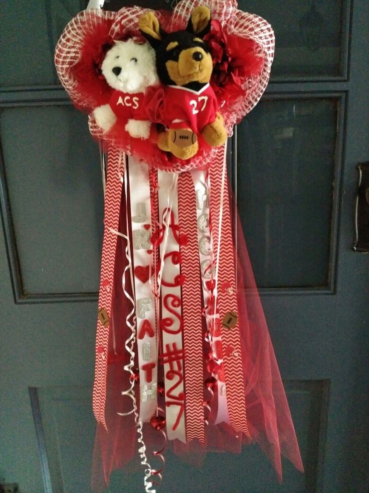 DIY homecoming mum.  The cheerleader girl dog barks when you squeeze her belly and the edge of the heart has red LED lights which look really cool at night.  It has 4 large red bells.  Hard to see it all in the photo.  Got all the supplies at WalMart.