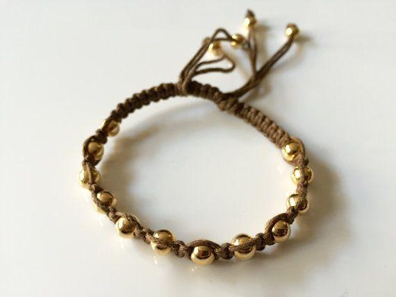 Woman #macrame #bracelet, gold plated pellets bracelet,  Macrame on a light…