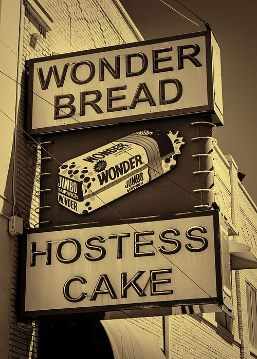 Passing through Memphis I spied this vintage Wonder Bread and Hostess Cake sign hanging outside the Wonder Bakery. Visions of PBJs, Twinkies, Ho Hos, Ding Dongs and Cupcakes filled my head. Ahh, the joys of childhood! Like a moth to a flame I was drawn to the sign. After snapping a few images I was off to the nearest convenience store for a Twinkies fix!   Wonder Bread was first sold in 1921, and in 1930 became one of the first breads sold pre-sliced. A wonder for its time!