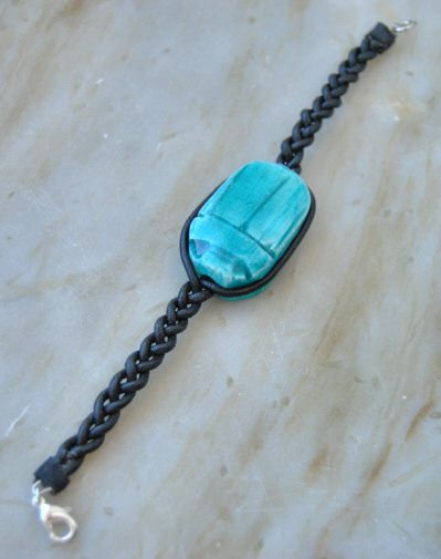 I bought this scarab bead at the National Museum in Edinburgh. I decided to make a bracelet out of it. This is how I did it. I cut an old leather cord that used to be a necklace necklace into 3 str...