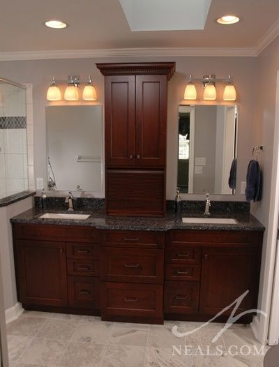 A traditional double vanity makes use of a vanity tower that separates the two sinks while adding storage.